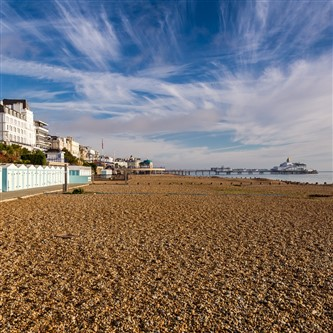 Eastbourne Beach and Pier on sunny day