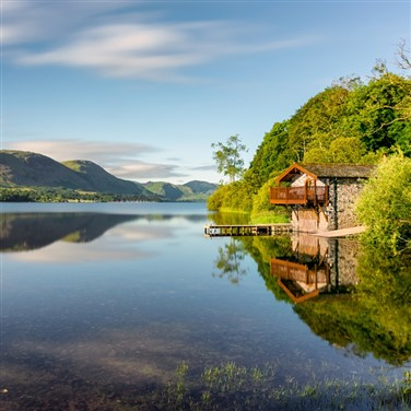 A boat sat on the waters of scenic Ullswater in the spectacular Lake District, Cumbria