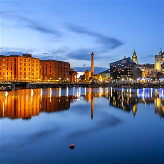 Buildings reflecting in the water during the evening at the Albert Dock in Liverpool