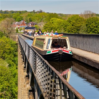A canal boat crossing the awe-inspiring Pontcysyllte Aqueduct in the Dee Valley, Wales