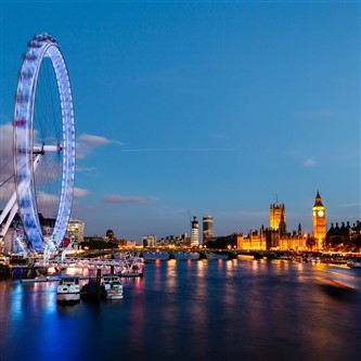 The London Eye and Houses of Parliament illuminated at night