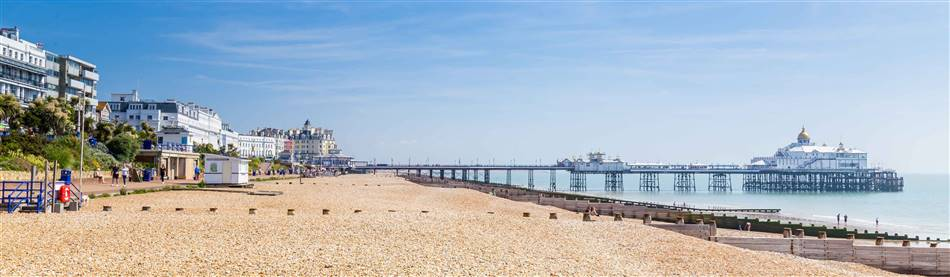 Panoramic image of Eastbourne Beach and Pier on sunny day