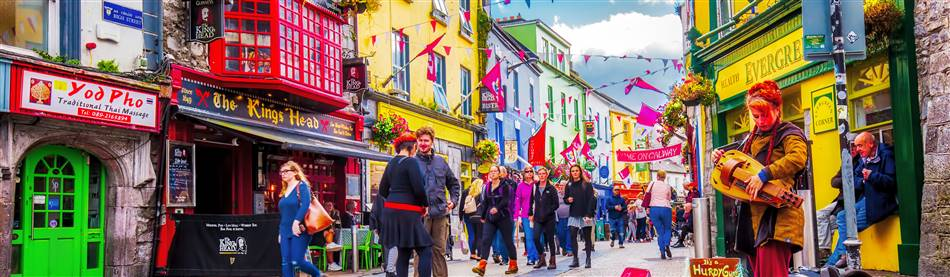 Colourful buildings and pedestrians in bustling Galway on Ireland's Spectacular West Coast