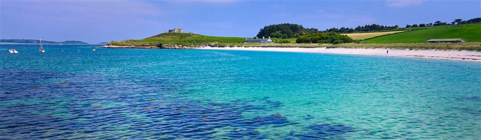 White sands and azure blue sea at a beach in the Scilly Isles, Cornwall