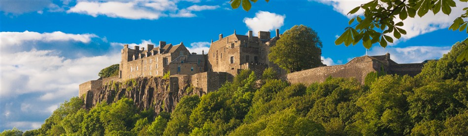 View of majestic Edinburgh Castle perched upon its volcanic crag