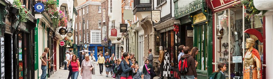 Pedestrains walking along an attractive shopping street in the picturesque city of York